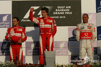 Podium: race winner Fernando Alonso, Scuderia Ferrari, with second place Felipe Massa, Scuderia Ferrari, and third place Lewis Hamilton, McLaren Mercedes