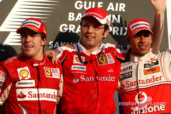 Podium: race winner Fernando Alonso, Scuderia Ferrari, with third place Lewis Hamilton, McLaren Mercedes, and Stefano Domenicali, Scuderia Ferrari Sporting Director