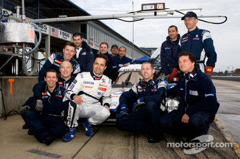 Pedro Lamy poses with Team Peugeot Total team members
