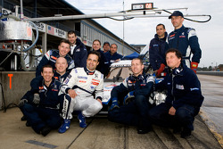 Pedro Lamy poses with Team Peugeot Total team members