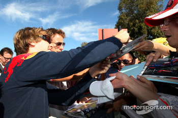 Sebastian Vettel, Red Bull Racing, Jenson Button, McLaren Mercedes, signs autographs