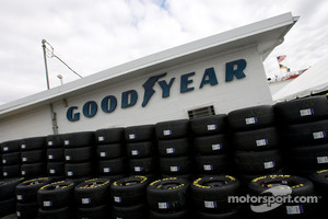 The Goodyear tires are stacked up in the garage area