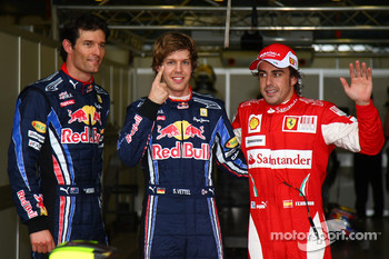 Pole winner Sebastian Vettel, Red Bull Racing, second place Mark Webber, Red Bull Racing, and third place Fernando Alonso, Scuderia Ferrari