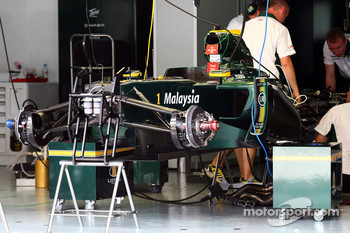 The Lotus team work on their cars