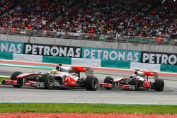 Lewis Hamilton, McLaren Mercedes leads Jenson Button, McLaren Mercedes