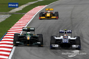 Heikki Kovalainen, Lotus F1 Team, Nico Hulkenberg, Williams F1 Team