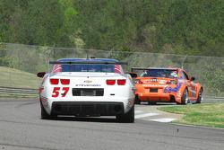 #57 Stevenson Motorsport Camaro GT.R: Andrew Davis, Robin Liddell follows #68 SpeedSource Mazda RX-8: Adam Christodoulou, John Edwards