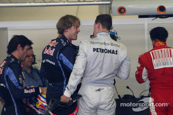 Pole winner Sebastian Vettel, Red Bull Racing, Michael Schumacher, Mercedes GP