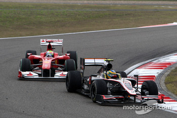 Bruno Senna, Hispania Racing F1 Team leads Felipe Massa, Scuderia Ferrari