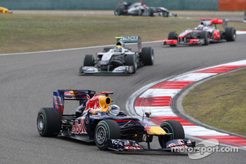 Sebastian Vettel, Red Bull Racing leads Nico Rosberg, Mercedes GP