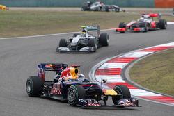 Sebastian Vettel, Red Bull Racing leads Nico Rosberg, Mercedes GP
