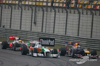 Adrian Sutil, Force India F1 Team and Sebastian Vettel, Red Bull Racing