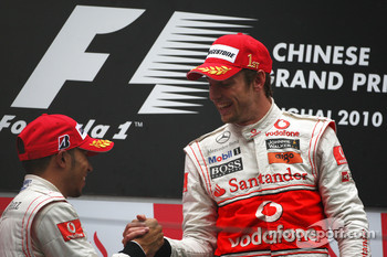Podium: race winner Jenson Button, McLaren Mercedes, with second place Lewis Hamilton, McLaren Mercedes
