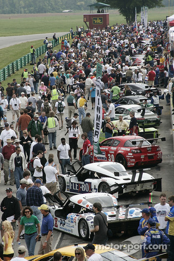 Race fans crowd pit road