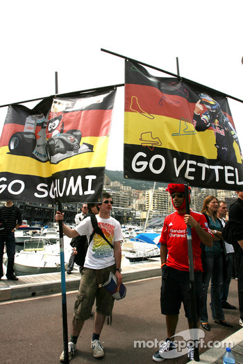 Michael Schumacher, Mercedes GP nd Sebastian Vettel, Red Bull Racing fans