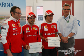 CEO of Aldar Properties presents Fernando Alonso, Scuderia Ferrari and Felipe Massa, Scuderia Ferrari with invitations to Yas Marina