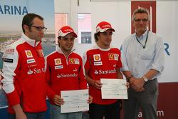 CEO of Aldar Properties presents Fernando Alonso, Scuderia Ferrari and Felipe Massa, Scuderia Ferrari with invitations to Yas Marina