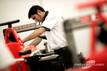 A GP3 technician works on the car of James Jakes
