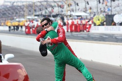 Race winner Dario Franchitti gets a hug from Tony Kanaan