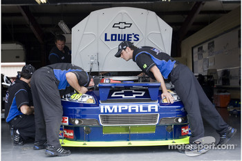 The Hendrick Motorsports crew prepares the car for practice
