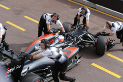 The McLaren team return Jenson Button, McLaren MP4-31 to the garage