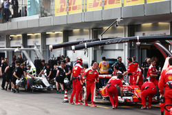 Sebastian Vettel, Ferrari SF16-H andf Nico Rosberg, Mercedes AMG F1 W07 Hybrid in the pits