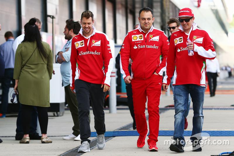 (L to R): Sebastian Vettel, Ferrari with Diego Ioverno, Ferrari Operations Director and Kimi Raikkonen, Ferrari