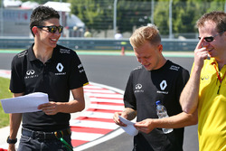 Esteban Ocon, Renault Sport F1 Team Test Driver and Kevin Magnussen, Renault Sport F1 Team walk the circuit