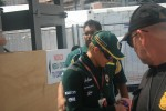 Heikki Kovalainen doing autographs