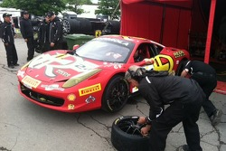 Rudy Courtade monitors tire pressures on Carlos K's 458 Italia
