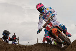 KTM's Kaven Benoit #1 holds off the corner charge of Honda's Jeremy Medaglia #21