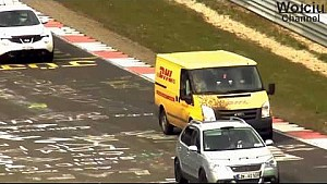 DHL van passes multiple cars at Flugplatz/Nurburgring