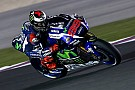 Rossi falls as Lorenzo sets hot pace on opening day of Qatar test