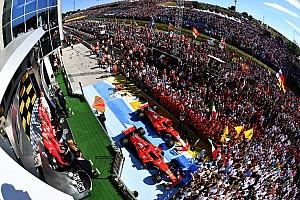 Formula 1 Özel Haber Fotoğrafın ardındaki hikaye: Vettel kutlamaların tadını çıkarıyor