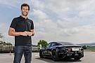 Automotive Mark Webber drives Porsche Mission E on test track