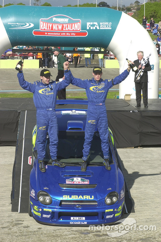 Richard Burns celebrates on the podium