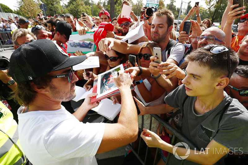 Fernando Alonso, McLaren, signs autographs for his fans