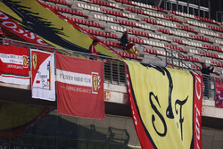 Ferrari flags on display in the pit straight grandstand