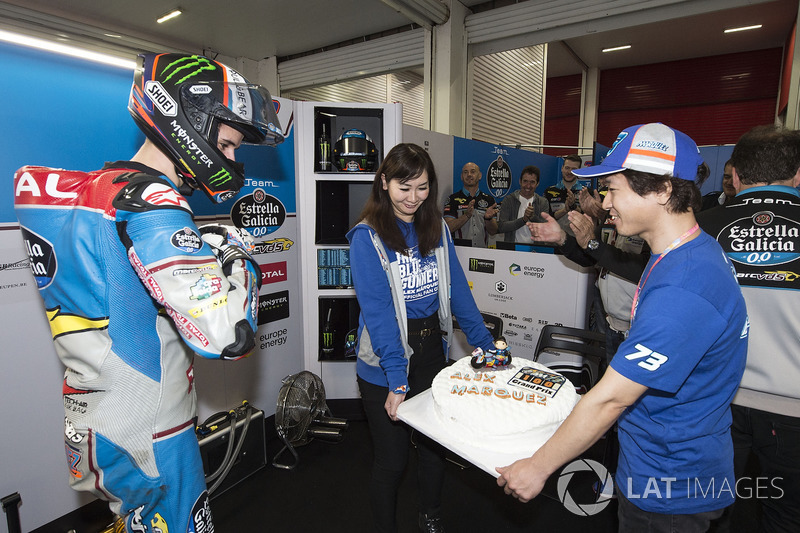 Alex Marquez presented with a cake to celebrate 100 GP starts