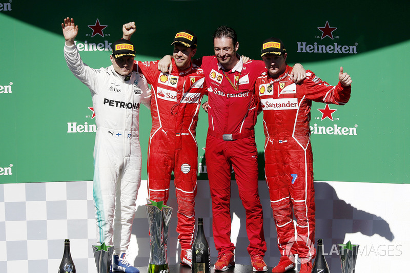 Podio: ganador Sebastian Vettel, Ferrari, segundo lugar Valtteri Bottas, Mercedes AMG F1 y tercer lugar Kimi Raikkonen, Ferrari