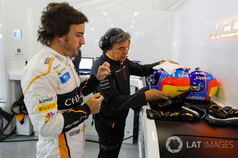 Fernando Alonso, McLaren, prepares to put on his helmet