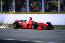 Michael Schumacher, Ferrari F300 kicks up sparks on the main straight
