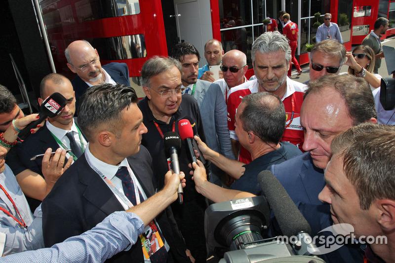 (L to R): Sergio Marchionne, Ferrari President and CEO of Fiat Chrysler Automobiles with Maurizio Arrivabene, Ferrari Team Principal