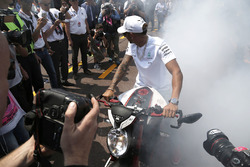 Lewis Hamilton, Mercedes AMG F1 W08 does a burn out on his MV Agusta Custom Dragster RR LH44 Superbike
