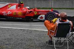 Kimi Raikkonen, Ferrari SF70H passes a Marshal in a deck chair