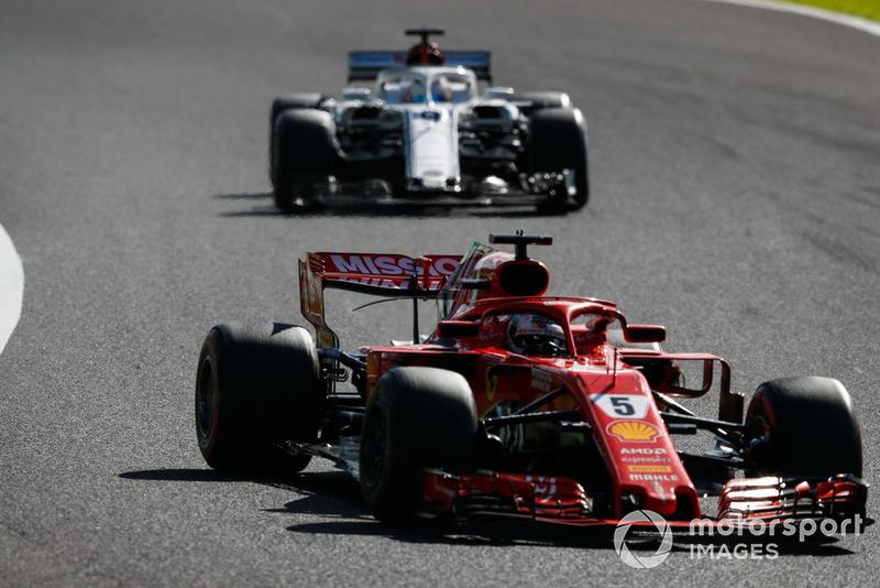 Sebastian Vettel, Ferrari SF71H, leads Marcus Ericsson, Sauber C37