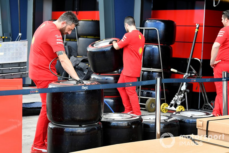 Ferrari mechanics check tyres
