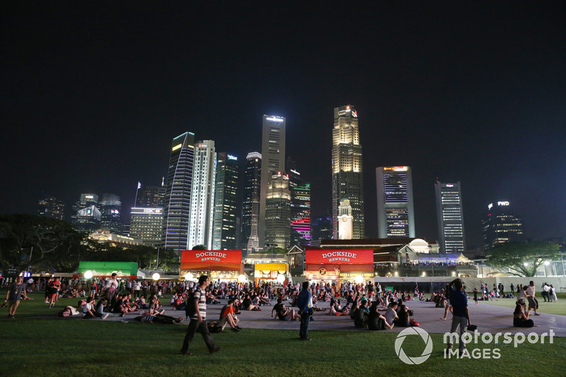 Fans and Singapore skyline