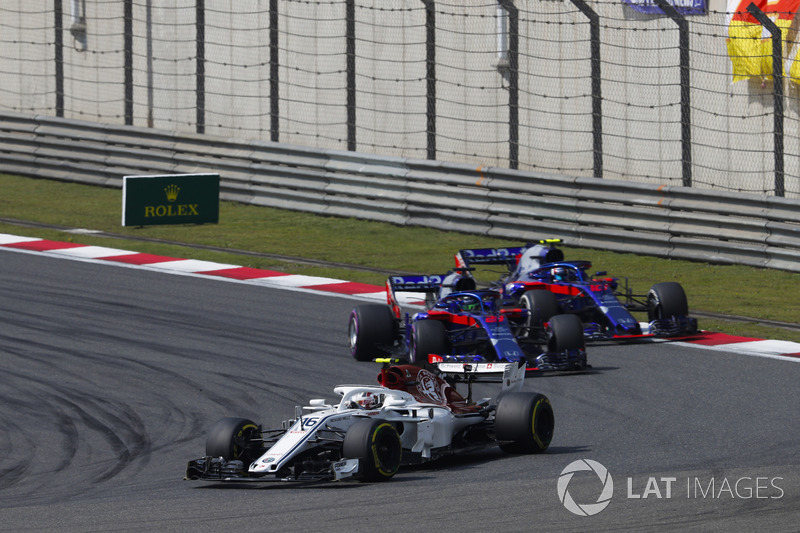 Charles Leclerc, Sauber C37 Ferrari, leads Brendon Hartley, Toro Rosso STR13 Honda, and Pierre Gasly