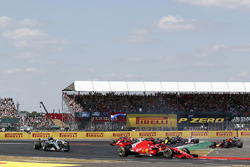 Sebastian Vettel, Ferrari SF-71H leads as Max Verstappen, Red Bull Racing RB14 and Lewis Hamilton, Mercedes-AMG F1 W09